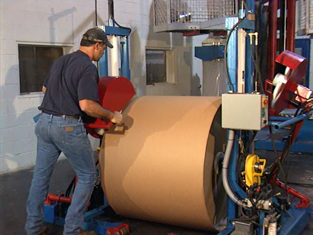 Our roll wrapping line gives mill quality roll wraps using any kraft wrap.